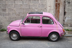 Old pink Fiat Nuova 500 city car, side view Royalty Free Stock Photos