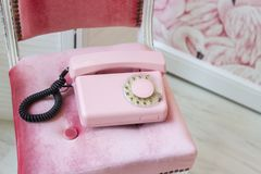 Old pink home phone. Wired vintage phone. Retro Royalty Free Stock Photography