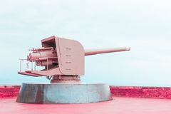 Old pink metal cannon, concept of peace and cessation of war royalty free stock photo