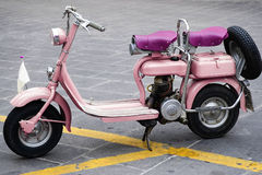 Old and pink motorbike Royalty Free Stock Images