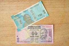 Old pink and new blue 50 denomination Indian Rupees Currency note after demonetisation