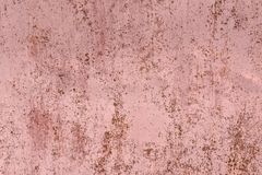 Old pink paint faded background with scratches. On it surface royalty free stock image