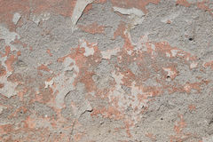 Old pink painted plaster gray peeling wall Royalty Free Stock Photo