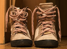 Old pink shoes. Pink shoes are in the hallway royalty free stock photography