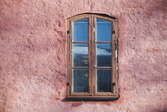 Old pink wall with window. Background texture of old pink wall with window Royalty Free Stock Photo