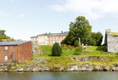 Old pinkish mansion on top of a hill. Old pinkish mansion behind water on top of a hill in Suomenlinna, Finland stock images