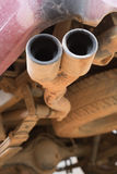 Old pipe car exhaust rusty Royalty Free Stock Image
