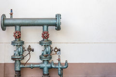 Old pipe and gate valve Stock Photos