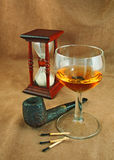 Old pipe and a glass of whiskey Stock Photography