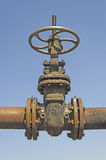 Old pipe with large valve Royalty Free Stock Photo
