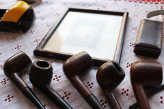 Old pipe smoking. For men stock photography