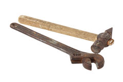 Old pipe wrench and a hammer. Stock Image