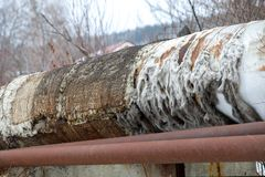 Old pipeline with torn insulation stock photography