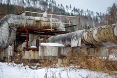 Old pipeline with torn insulation stock images
