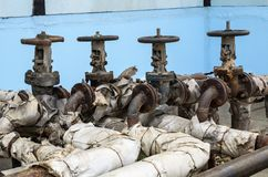 Old pipeline valves Stock Photo