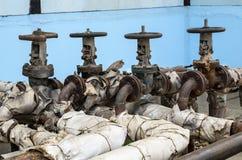 Old pipeline valves Stock Photo