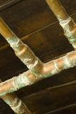 Old pipes. Old copper water pipes in a residential basement Stock Photos