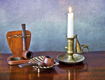 Old pipes and candle Royalty Free Stock Photo