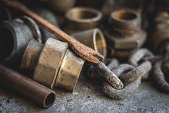 Old pipes, parts, rusty wrench. Garage and vintage, retro concept stock image