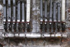 Old pipes with valves and ads Stock Photos