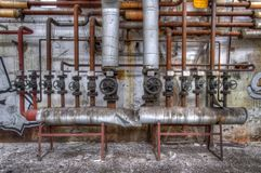 Old pipes with valves Royalty Free Stock Photos