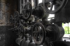 Old pipes with valves Royalty Free Stock Photography