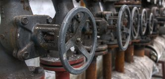 Old pipes with valves Stock Photos