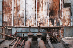 Old pipes and valves at an oil terminal Royalty Free Stock Photo