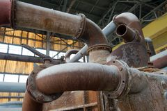 Old pipes and valves in petrochemical factory Royalty Free Stock Photos