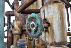 Old pipes and valves in petrochemical industry in Romania. Old pipeline and valves in petrochemical plant Royalty Free Stock Photos