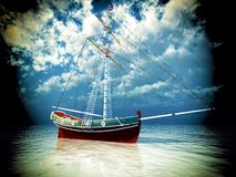 Old pirate frigate on stormy seas. Old pirate frigate on cruise before gale strikes Stock Photography