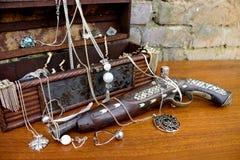 Old Pirate Gun with Treasure. Box Royalty Free Stock Image