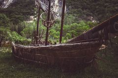 Old pirate sailboat in the jungle. Wild red flowers. image for background use royalty free stock photo