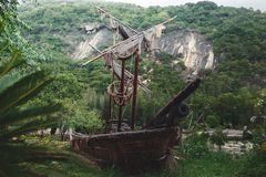 Old pirate sailboat in the jungle. Wild red flowers. image for background use stock photo