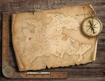 Old pirates` map with brass compass. Adventure and travel concept. 3d illustration. royalty free stock photography