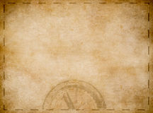 Old pirates treasure map with compass. Aged pirates map background. Old treasure map with compass Royalty Free Stock Photo