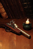 Old Pistol And Books Royalty Free Stock Photography