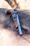 Old Pistol. Elegant vintage pistol on old wooden log Royalty Free Stock Images