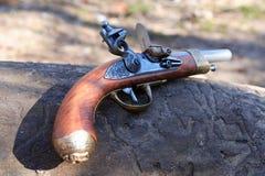 Old Pistol. Elegant vintage pistol on old wooden log Stock Photography