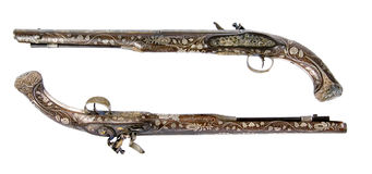 Old pistol inlaid with bone and enamel. Ceremonial weapon royalty free stock image