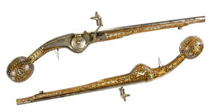 Old pistol inlaid with bone and enamel. Ceremonial weapon stock photography
