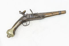 Old pistol. On white background Royalty Free Stock Images