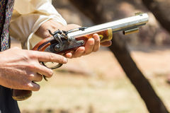 Old pistol. Young man holding an old pistol Stock Photography