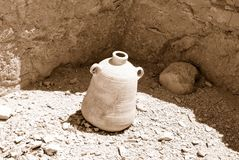Old pitcher. On a background of ancient wall. Sepia Royalty Free Stock Photo