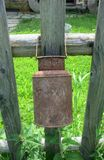 Old pitcher on fence. Old earthenware jug on the wooden fence Royalty Free Stock Photos