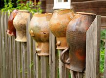 Old pitchers. Old pitcher on rural fence Stock Image