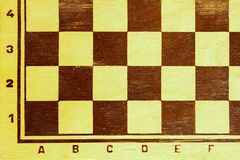 Old checkered square chess Board stock photos