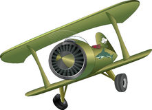 The old plane biplane. The toy green plane with a shark on one side Royalty Free Stock Photo