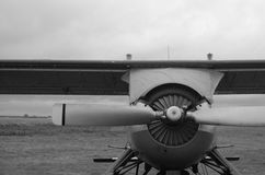 Old plane in black and white colors. An old obsolete aircraft propeller on sky fon Royalty Free Stock Photos