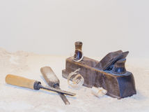 Old plane and a chisel on a light background.  royalty free stock photo